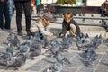 Children feeding pigeons
