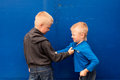 Children fight between two angry aggressive brothers kids boys Stock Photos