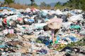 Children find junk for sale and recycle them in landfills, the lives and lifestyles of the poor, Child labor, Poverty and Royalty Free Stock Photo