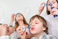 Children firends blowing bubbles Royalty Free Stock Photography