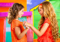 Children firends girls in vacation at tropical colorful house playing together Royalty Free Stock Images