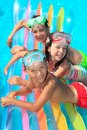 Children on float in pool Royalty Free Stock Photo