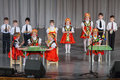 Children in folk costume performs on stage moscow apr district competition crystal droplet april moscow russia Royalty Free Stock Photos