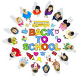 Children forming a circle with texts back to school multi ethnic Stock Images