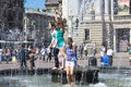 Children and fountain are cooled in the heat in the city in the center of lviv Stock Images