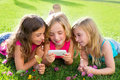 Children friend girls playing internet with smartphone Royalty Free Stock Photos
