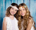 Children friends girls hippie retro style smiling together beautiful on blue wood Royalty Free Stock Images