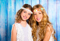 Children friends girls hippie retro style smiling together beautiful on blue wood Stock Image