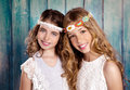 Children friends girls hippie retro style smiling together beautiful on blue wood vintage color Royalty Free Stock Photo
