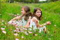 Children friends girls on spring poppy flowers meadow with Stock Photo