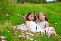 Children friends girls on spring poppy flowers meadow with Royalty Free Stock Image