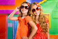 Children friends girls in vacation at tropical colorful house with fashion sunglasses Royalty Free Stock Image