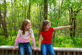 Children friends playing pointing finger to jungle park sister relaxed forest outdoor Royalty Free Stock Photo
