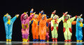 Children in funny colored overalls aliens dancing on stage the performance of s collectives st petersburg russia Stock Photos