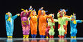 Children in funny colored overalls aliens dancing on stage the performance of s collectives st petersburg russia Stock Images