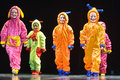 Children in funny colored overalls aliens dancing on stage the performance of s collectives st petersburg russia Royalty Free Stock Images