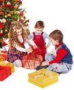 Children with gift box near christmas tree isolated Stock Photos