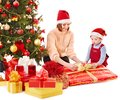 Children with gift box near christmas tree isolated Royalty Free Stock Image