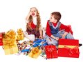 Children with  gift box and sweet. Stock Images
