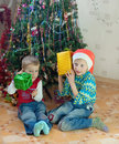 Children with gifts Stock Photos