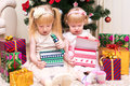 Children with gifts near Christmas tree Royalty Free Stock Photo