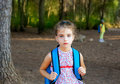 Children girl hiking with backpack in forest Stock Photo