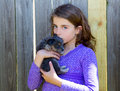 Children girl kissing her puppy chihuahua doggy Royalty Free Stock Photo