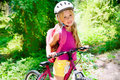 Children girl riding bicycle outdoor in forest Royalty Free Stock Images
