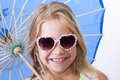 Children girl with umbrella and sunglasses smiling Royalty Free Stock Image