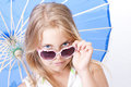Children girl with umbrella and sunglasses smiling Royalty Free Stock Photos