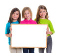 Children girls group holding blank white board copy space Royalty Free Stock Photo