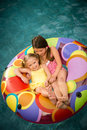 Children girls swimming pool or in inner tube floating in water Royalty Free Stock Photos