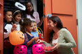 Children Going Trick Or Treating With Mother Royalty Free Stock Photo