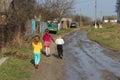 Children going in ukrainian village by stream after rain Stock Photography