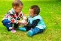 Children grab toys Royalty Free Stock Photo