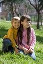 children on grassy hillside Royalty Free Stock Photo