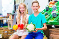 Children grocery shopping in corner shop Royalty Free Stock Photo