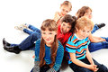 Children group of cheerful sitting on a floor together isolated over white Royalty Free Stock Images