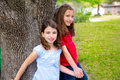 Children group friend girls playing on tree friends trunk at the park outdoor Royalty Free Stock Images