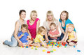 Children Group with Mothers Playing Toy Blocks. Little Kids Earl Royalty Free Stock Photo