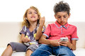 Children hands-free headset playing smart phone Royalty Free Stock Photo