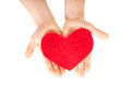 Children hands giving heart love concept red made from felt and care Royalty Free Stock Photo