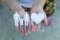 Children hands holding small model of heart and family , concept Royalty Free Stock Photo
