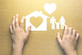 children hands with small model of house and heart and family Royalty Free Stock Photo
