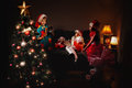 Children have a christmas group of in hat with adorable girl play with toy carriage and boy make picrure Stock Photography