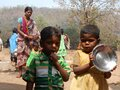 A Children have gathered in the hand pump for water