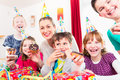 Children having cupcakes celebrating birthday Royalty Free Stock Photo