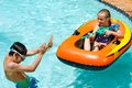 Children having fun in pool close up of girl spraying boy with water gun Stock Images