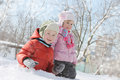 Children having fun in snow sister and brother Royalty Free Stock Image