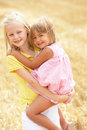 Children Having Fun In Summer Harvested Field Stock Photography